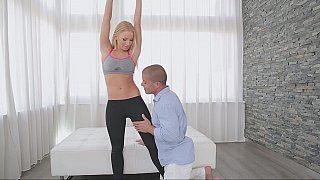 Well shaped blonde sweety doing Yoga
