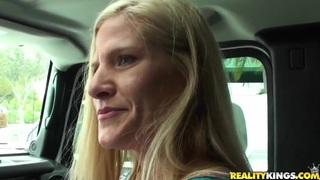 Mature blondie sucks throbbing penis in a car