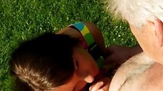 A senior man bangs a teen outside
