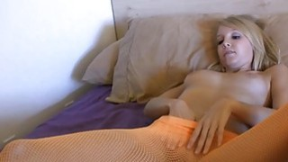 Young blonde Elle Brooks enjoys a glass dildo