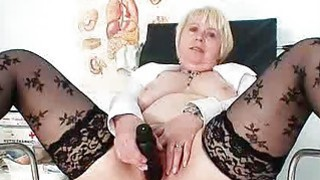 Huge boobies older madam in uniform masturbates bu