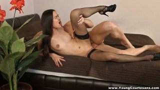 young courtesan keeps her stockings on while fucking