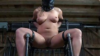 Manacled up chick is punished