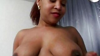 Chubby black chick playing with dildo in bedroom