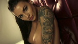Alluring temptress performing a hot dance half naked