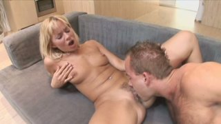 Seductive blonde bitch Cindy Dollar gives head and fucks on her side