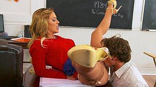 Sex teacher eaten out right on her desk